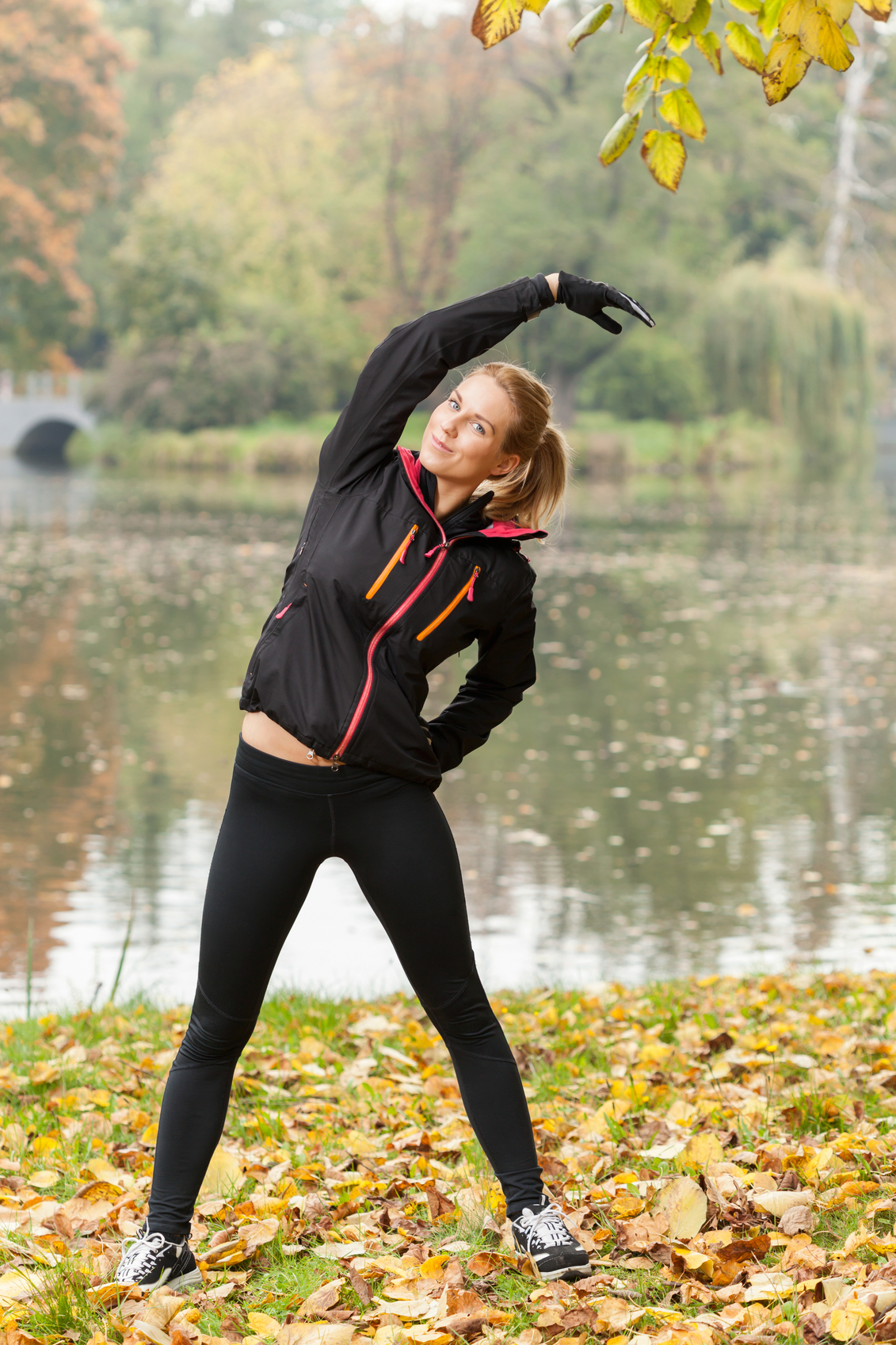 Break for stretching in the park in autumn