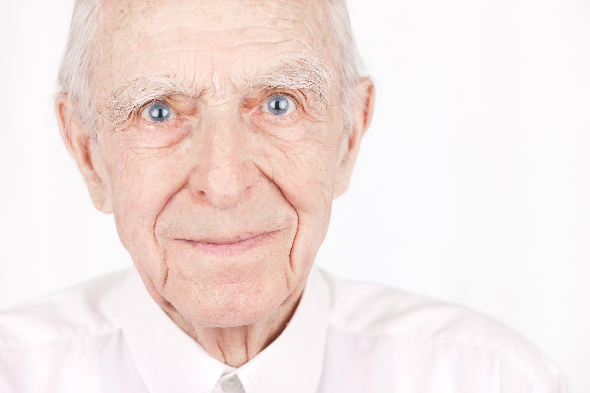 Smiling senior man portrait on white. Canon 1Ds Mark III