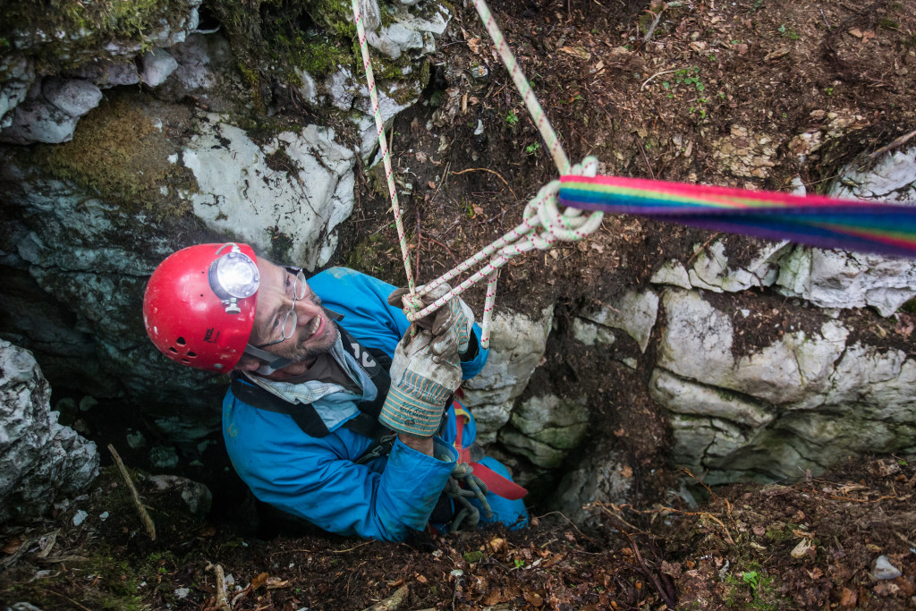 Speleologist Rémy Wenger, from the swiss institut of speleology(ISSKA) goes up from the subterranean cave after cleaned out from decades old wastes in Baudichonne near La Rippe, Switzerland, August 24, 2017. ©Pierre Albouy