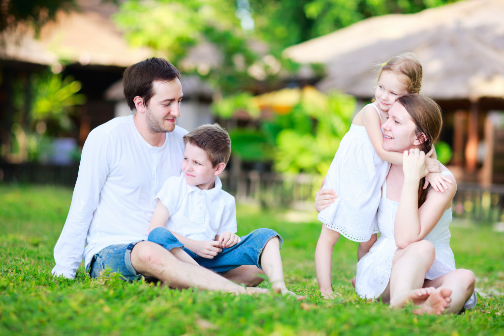Beautiful family outdoors on summer day